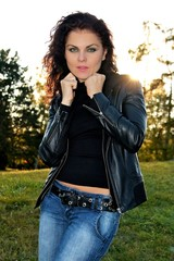 young women posing outdoor in leather jacket