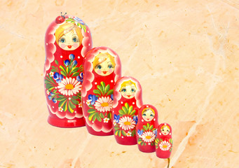 Babushka doll family on marble