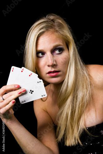 Attractive young woman playing poker