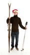 Christmas young  man with old wooden ski, full length.