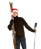 smiling Christmas young  man with old wooden ski
