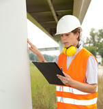 male constructor checking work progress in construction site