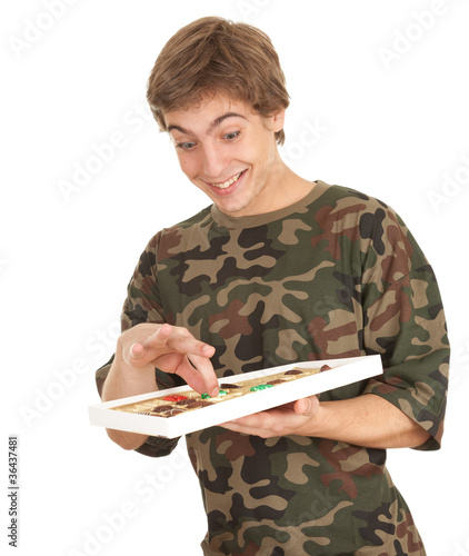 happy young man with chocolates