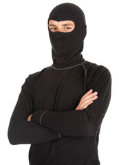 male thief in balaclava with crossed arms