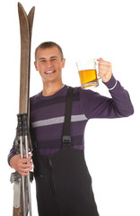 smiling young man with old skis and mug of beer