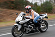 Speeding Motorcycle Woman