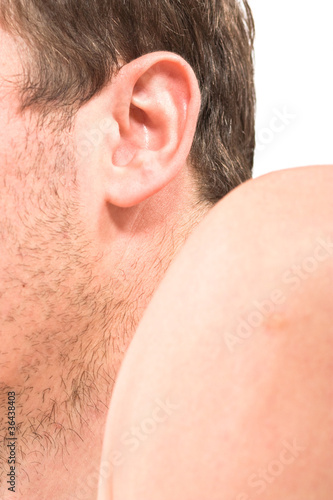 Male unshaven cheek, ear, arm, body part