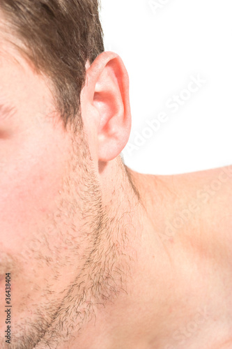 Male unshaven cheek, ear, neck, body part