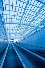 escalator in modern interior airport