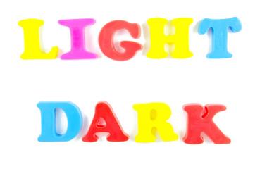 light and dark written in fridge magnets
