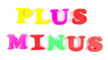plus and minus written in fridge magnets
