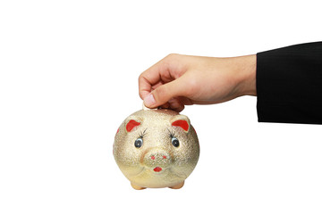 isolated hand put a coin in a piggy
