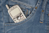 Cell phone in pocket of blue jeans.