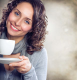 Fototapety Beautiful Woman with cup of Tea or Coffee