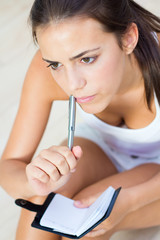 portrait of beautiful woman whit notebook at home