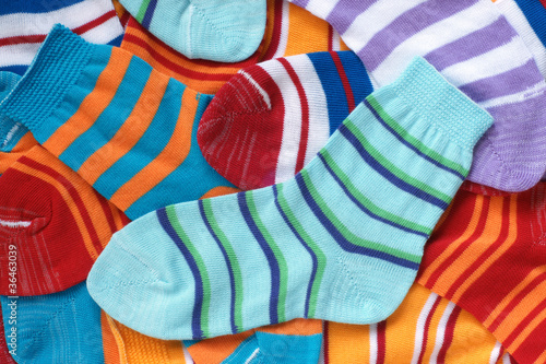Many pairs of child's striped socks