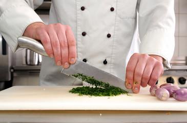 der Koch bei der Arbeit