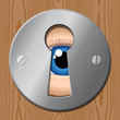 eye looks through keyhole – peeping tom