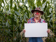 scarecrow holding copy space sign