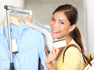 Shopping woman showing credit card