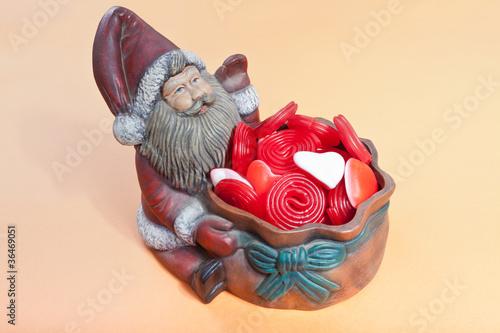 figura de Santa Claus con bolsa de golosinas