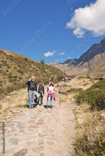 Group of people walking in the nature