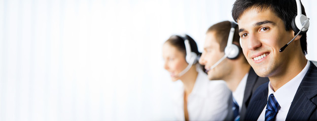 Customer support phone operators at workplace