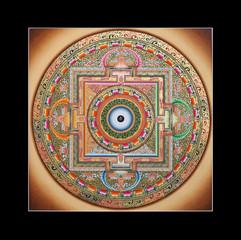 Inner part of ancient tibetan tangka Ohm Mandala on black