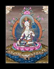 Inner part of ancient tibetan tangka White Tara on black