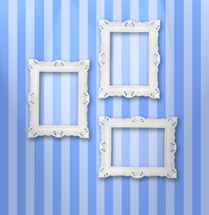 Set of white ornamental frames on a stripy wallpaper