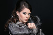 Fashion Winter beauty in fur coat over black