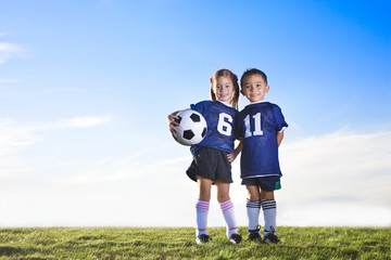 Cute youth soccer players wearing their team uniforms