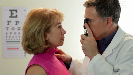 Optometrist checking his patient