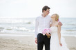 Beach wedding: bride and groom by the sea