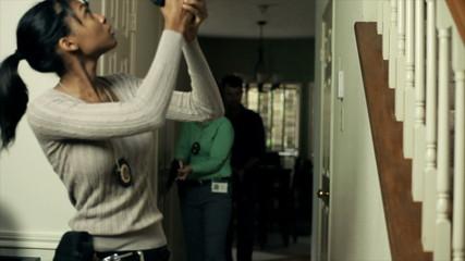 CSI detectives enter a home to secure a crime scene.