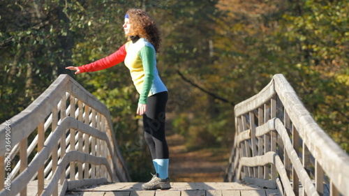 Beautiful  girl doing stretching exercise on a bridge
