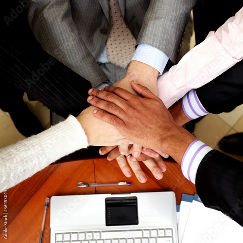 business people hands on top of each other. View from above