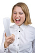 Business woman shouting into the telephone receiver