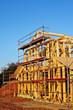 carpenters setting up prefabricated framework