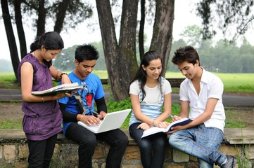 Indian Students doing group study outside college campus.