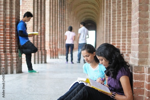 Indian college students preparing for examination.