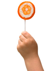 lollipop in the hand of a child