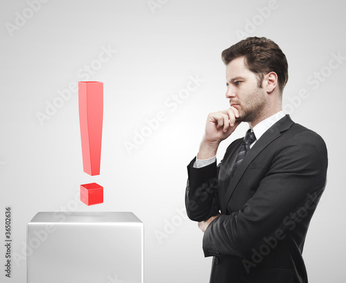 Businessman look at the red exclamation mark