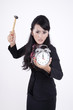Angry Businesswoman with hammer and alarm clock
