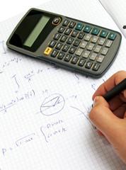 Scientific calculator on notebook paper