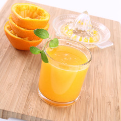 Orange juice freshly squeezed from fresh fruits with a juicer