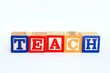 The word teach in alphabet blocks