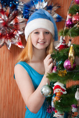 Teen girl decorates spruce