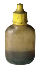 dirty old oil bottle with yellow cap
