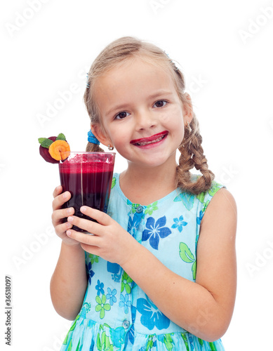 Having a freshly squeezed beetroot and carrot juice